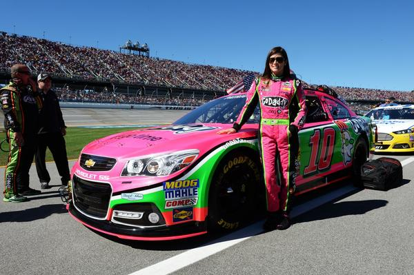 Danica Patrick, driver of the #10 GoDaddy Breast Cancer Awareness Chevrolet, stands on the grid prior to the NASCAR Sprint Cup Series Camping World RV Sales 500 at Talladega Superspeedway.
