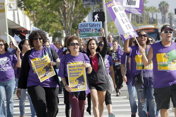 Service Employees International Union members protest for higher wages in downtown Los Angeles on Oct. 1, 2013.