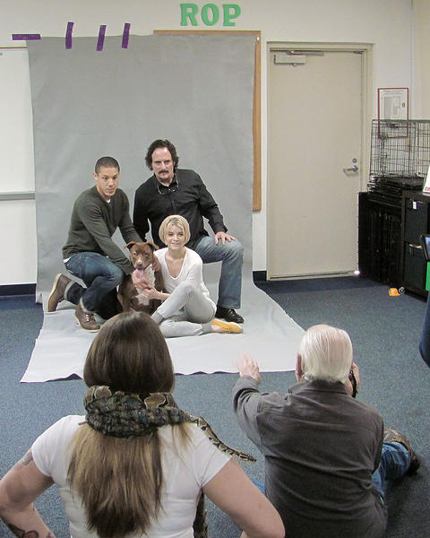 "Theo Rossi, left, and Kim Coates, actors from the FX TV series ""Sons of Anarchy"" and Sarah Jones, of the TV series ""Alcatraz,"" pose for promotional photographs for the Volunteers of the Burbank Animal Shelter's new campaign ""Love. Protect. Adopt."""