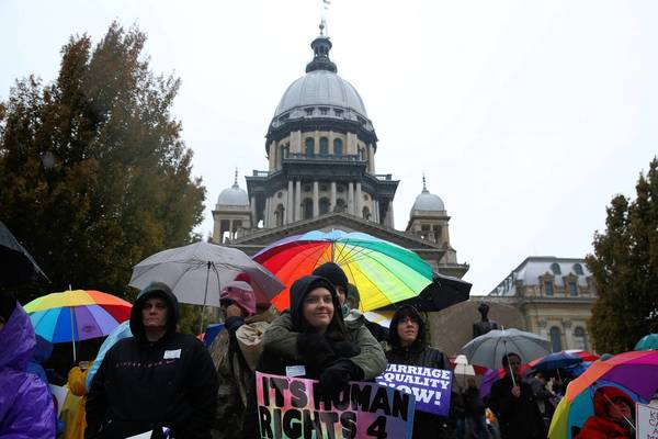 Supporters of gay marriage rally at the Capitol in Springfield on Tuesday, the first day of the fall veto session.