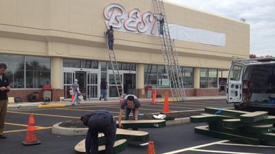 Workers at Best Market prepare to open a store in Newington. (Rick Hartford)