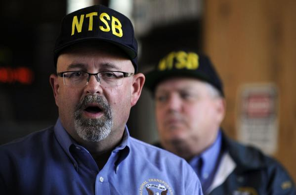 The National Transportation Safety Board's James Southworth, left, is the lead investigator into the deaths of two BART workers who were struck and killed by a train Saturday.