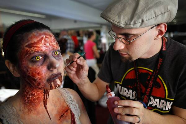"Makeup artist John Wrightson transforms Aly Marianelli into ""Forest Demon Mia"" for Universal Studios' ""Halloween Horror Nights."""