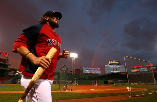 Boston's Jarrod Saltalamacchia runs off the field during a team practice session at Fenway Park on Tuesday.