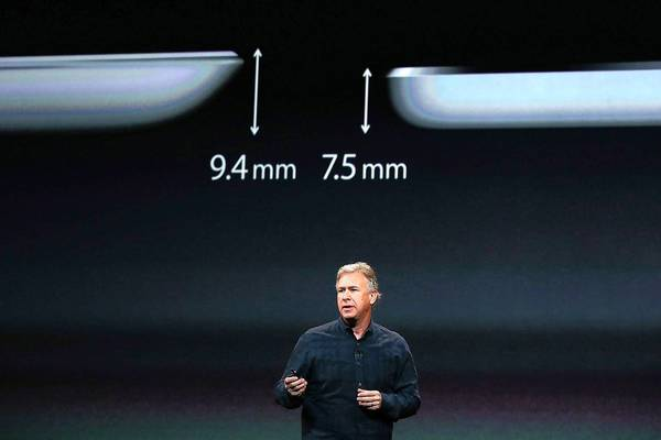Apple's fifth-generation iPad, now called iPad Air, is 20% thinner than the last iPad, and only two-thirds as heavy. Above, Phil Schiller, Apple's senior vice president of worldwide marketing, announces the new tablet Tuesday at the Yerba Buena Center in San Francisco.