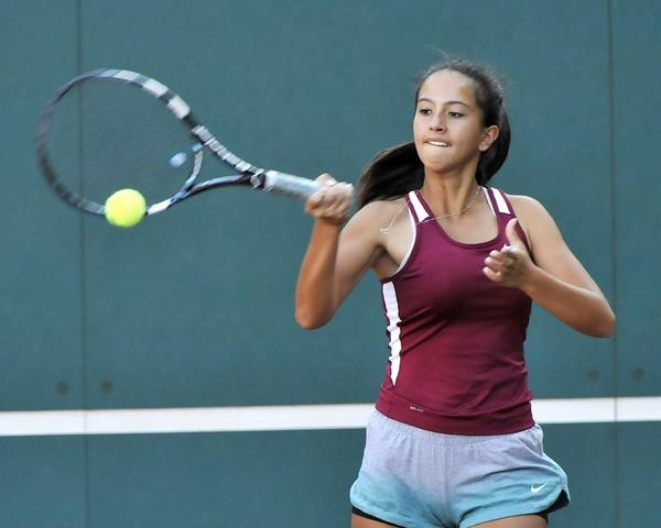 La Canada's Ally McKenzie returns a shot with a forehand in a Rio Hondo League singles tennis match against Temple City at La Canada High on Tuesday. The Spartans won, 12-6. (Tim Berger/Staff Photographer)