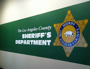 An L.A. County sheriff's deputy was convicted Tuesday of battering and threatening his former girlfriend.