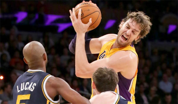 Lakers big man Pau Gasol, center, tries to work his way past Utah's John Lucas III, left, and Gordon Hayward, right, during L.A.'s 108-94 victory over the Jazz at Staples Center on Wednesday.