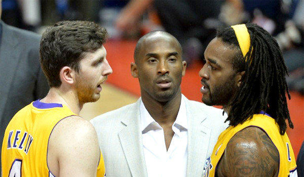 Kobe Bryant, center, listens as teammates Ryan Kelly, left, and Jordan Hill talk during a timeout in a preseason game against the Golden State Warriors in Shanghai on Oct. 18.