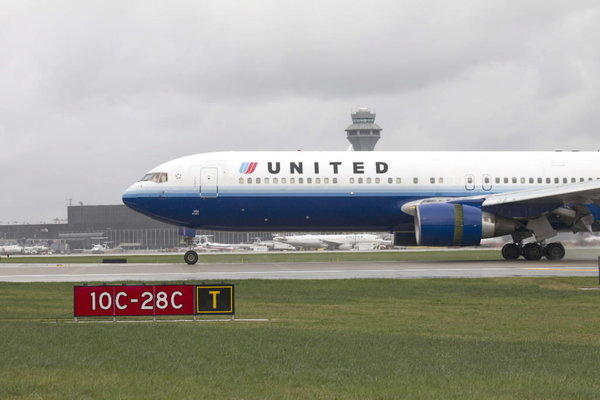 A United Airlines plane arrives on the newest runway at O'Hare International Airport Oct. 17.