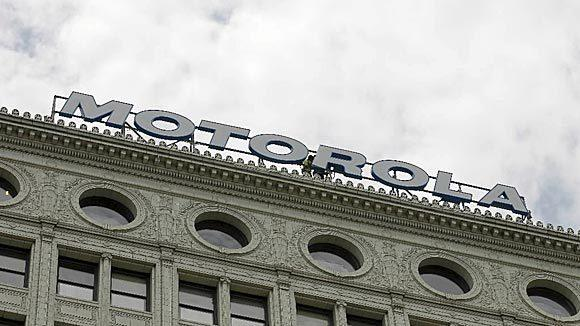 Workers finish putting a Motorola sign where the Santa Fe sign once stood atop 224 S. Michigan Ave. in 2012.