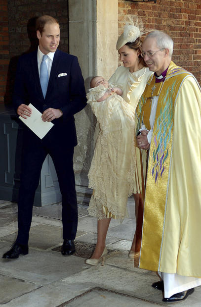 Britain's Prince William, and Catherine, Duchess of Cambridge, with their son, Prince George, leave the Chapel Royal in St James' Palace in London, with the Archbishop of Canterbury Justin Welby after the christening of the 3-month-old Prince George.