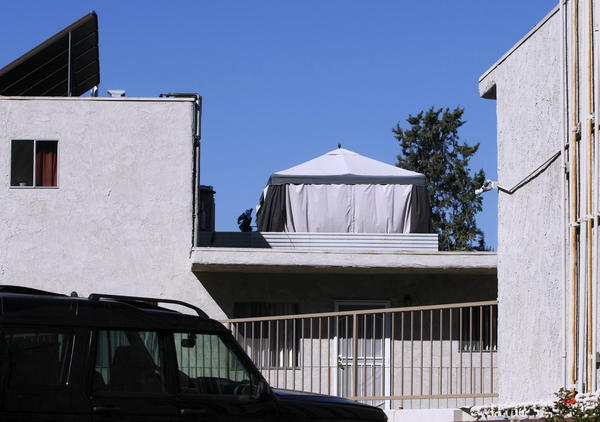 A large tent, or cabana, sits on top of the roof of an apartment building on the 500 block of East Cypress Street in Glendale on Wednesday, Oct. 16, 2013.