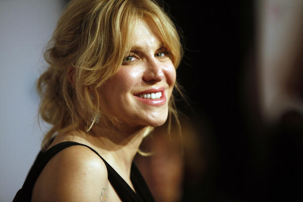 Courtney Love, all smiles at the Elton John AIDS Foundation's benefit gala in New York, has a memoir in the work.
