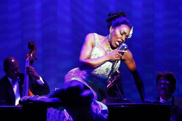 """Dee Dee Bridgewater portrays Billie Holiday in """"Lady Day"""" in New York, with bassist James Cammack and drummer Jerome Jennings."""
