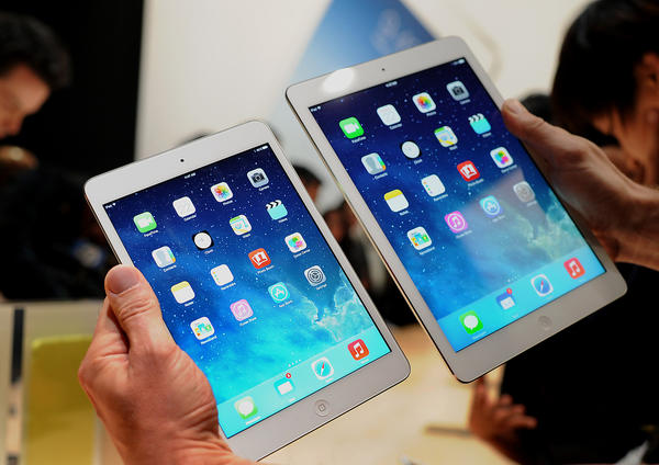T-Mobile will be selling LTE versions of Apple's new iPad mini with Retina display, left, and the iPad Air, right, for $0 down.