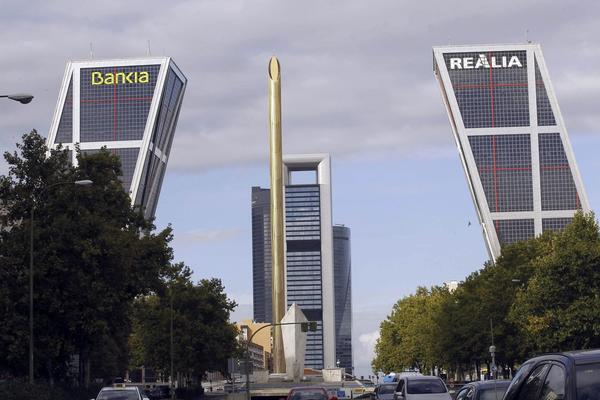 The Bank of Spain in Madrid, above, announced that the nation's recession was over.