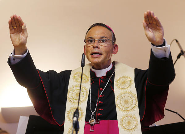 German Bishop Franz-Peter Tebartz-van Elst of Limburg, shown in this August photo blessing a new kindergarten in Frankfurt, was suspended by Pope Francis on Wednesday as the Vatican investigates a scandal over his lavish spending on trips, cars and a $42-million palatial residence renovation.