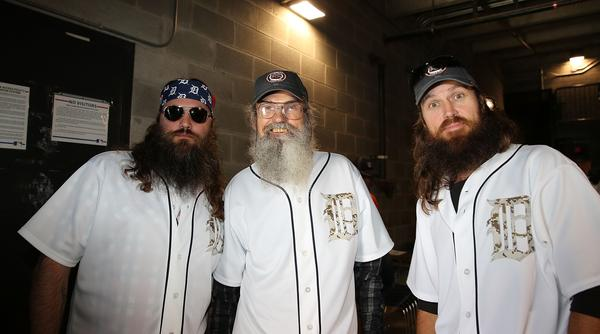 "Cast members of ""Duck Dynasty,"" from left, Willie Robertson, Jase Robertson and Phil Robertson, get ready to throw out the first pitch before a Detroit Tigers-Chicago White Sox game in Detroit."