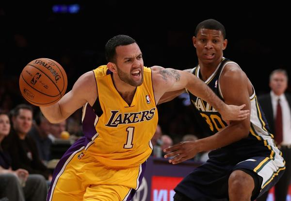 Jordan Farmar, shown dribbling past Utah's Scott Machado on Tuesday night, is leading the Lakers with 13.7 points and 4.7 assists a game during the preseason.
