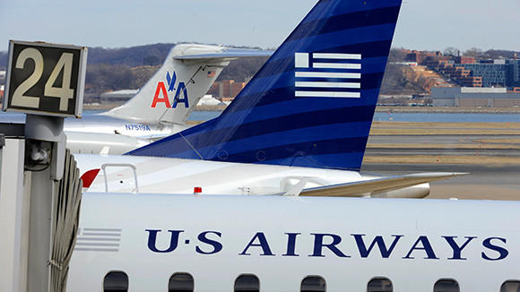 A view of two US Airways Express planes next to an American Airlines plane at the Ronald Reagan Washington National Airport.