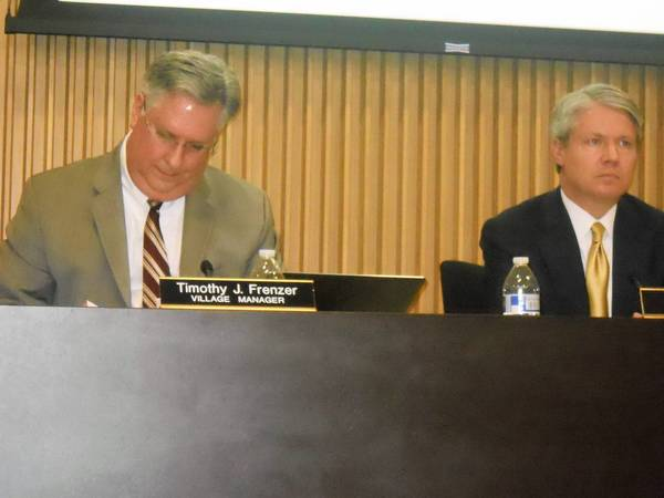 Wilmette Village Manager Timothy Frenzer, left, and Village President Bob Bielinski, during a meeting at which the village board issued $10 million in bonds to pay for capital improvement projects.
