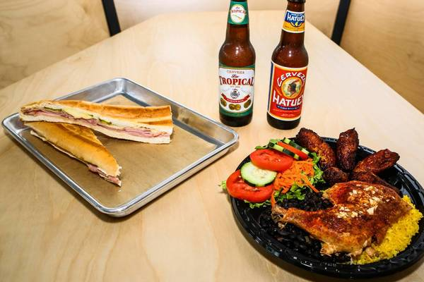 Cuban sandwich and Spanish chicken dinner paired with Cuban beer at the new Black Bean Deli in Orlando.