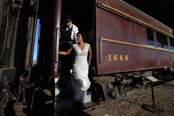 Tony Azevedo, 61, left, escorts bride Anna Thompson from a vintage train car to a horse carriage for her wedding at Azevedo's Double T ranch in the San Joaquin Valley. Drought and high feed prices have devastated the dairy industry in California, but some dairies are bringing in extra cash by hosting weddings.