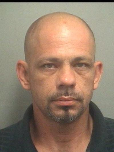 Carmine Rozzo, 40, of Lake Worth, is accused of stealing candy bars from a gas station, then stealing a bag from a college students jeep parked outside.