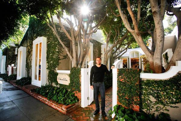 New York developer Zach Vella stands outside a building he just bought on Melrose Place. The complex is drawing a VIP list of tenants including a new flagship store for Mary-Kate and Ashley Olsen.