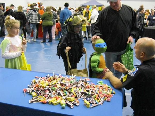 Young trick-or-treaters line up for candy at Mundelein's Boo Bash.