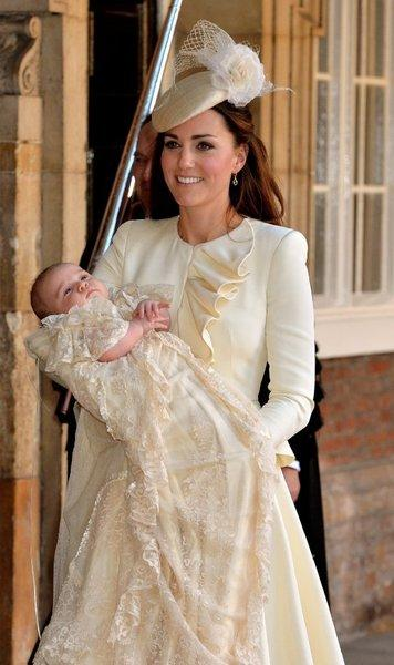 Catherine, Duchess of Cambridge, carries her son, Prince George of Cambridge, after his christening in London. He wears a replica of the royal family's historic 1841 christening robe.