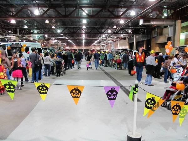 Families enjoyed a safe place to have some Halloween fun at last year's Trunk or Treat event in Arlington Heights. Businesses and organizations will once again decorate their vehicles for the kids to trick or treat inside the public works garage at 222 N. Ridge on Friday, Oct. 25.
