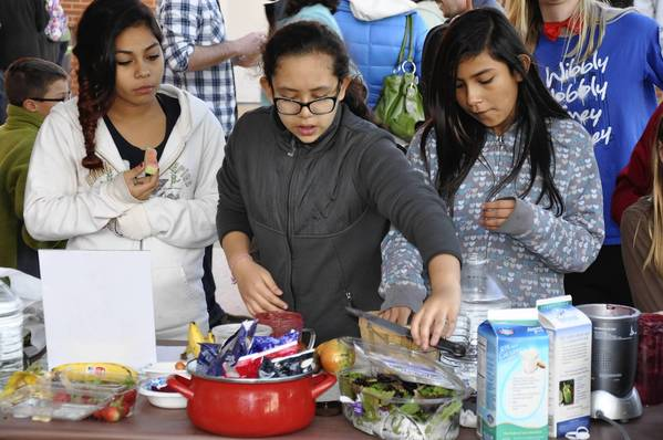 Thomas Middle School students Melanie Esquivel, Bella Vasquez and Astrid Ponce make smoothies with fruits and vegetables at a Garden Harvest held at the middle school that featured healthy dishes students cooked using vegetables from their school garden.