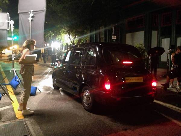 A production crew works to film Visit Orlando's commercial for the British market in downtown Orlando.