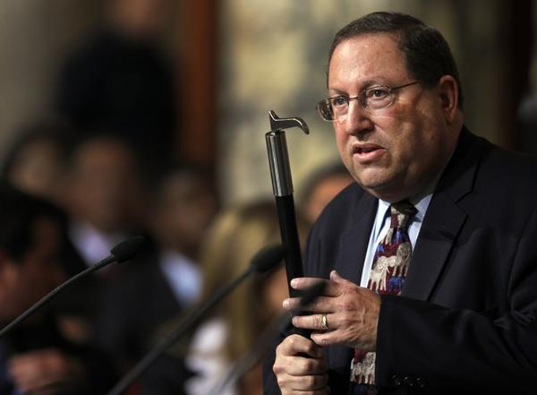Los Angeles City Councilman Paul Koretz holds a bullhook as he argues for a citywide ban on the implement used to manage and control elephants.