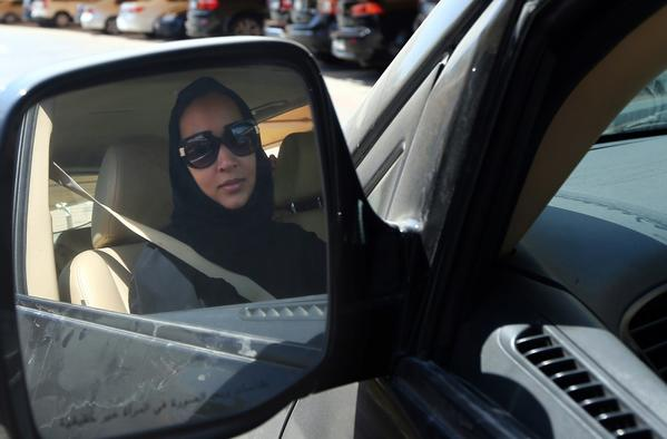 Saudi women's rights activist Manal Al Sharif, who now lives in Dubai, drives her car in the Gulf Emirate city on Tuesday in solidarity with Saudi women preparing to take the wheel on Saturday to press for women's right to drive in the kingdom.