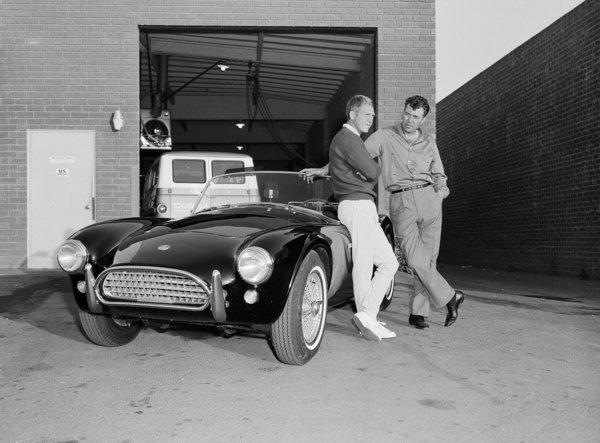 Actor Steve McQueen, left, and racer Carroll Shelby stand by McQueen's Ford Cobra roadster in 1963 in Los Angeles. Shelby's former Marina del Rey headquarters was sold.