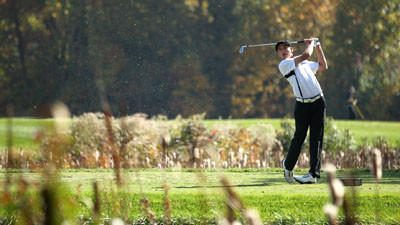Marriotts Ridge's Bennett Buch tees off on the 11th hole during the final round of the State Championship Tournament at the University of Maryland golf course Oct. 24.