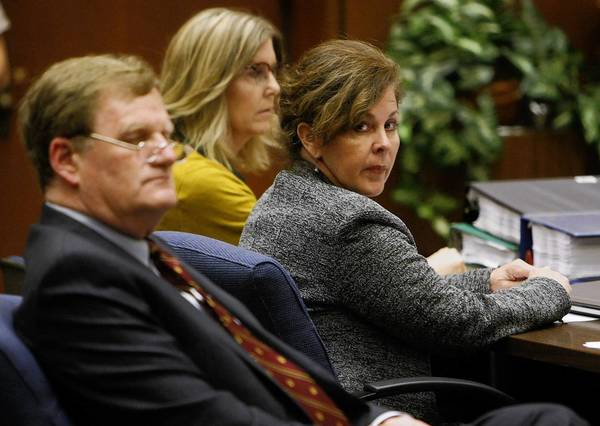 FORMER BELL Assistant City Manager Angela Spaccia, center, who is charged with misappropriation of public funds and other criminal counts, listens to opening statements in Los Angeles County Superior Court at her trial. At left is her attorney Harland Braun; behind her is investigator Leslie Robertson.