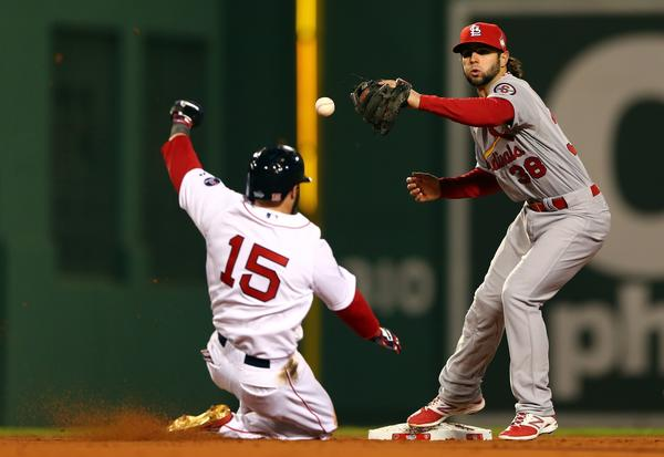 St. Louis' Pete Kozma drops the ball as the Red Sox's Dustin Pedroia slides into second base during Game 1 of the World Series on Wednesday.