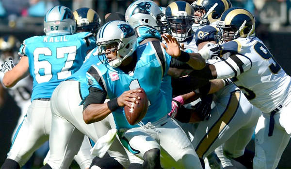 Panthers quarterback Cam Newton scrambles away the Rams defense during Carolina's 30-15 victory over St. Louis on Sunday.
