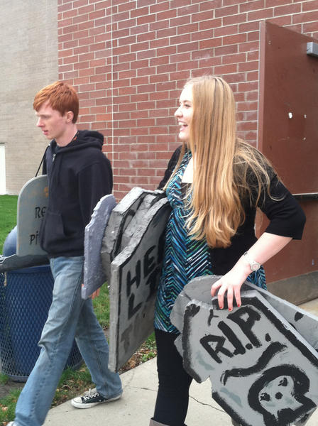 Central Drama Club students Jacob Womack and Gabbie Brandt transport props after school for the Haunted Forest.