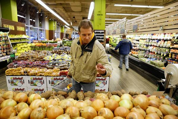 Bill Rastello looks over the potatoes Wednesday in the produce department of the newly refreshed Jewel-Osco at State and Ohio streets.