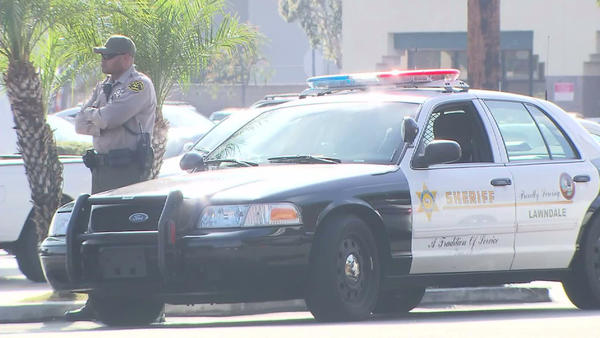 A Los Angeles County sheriff's deputy is outside Lawndale High School after a student was arrested on suspicion on making threats to shoot other students via Twitter.