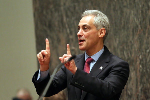 Mayor Rahm Emanuel gestures to someone in the gallery before giving his budget address.