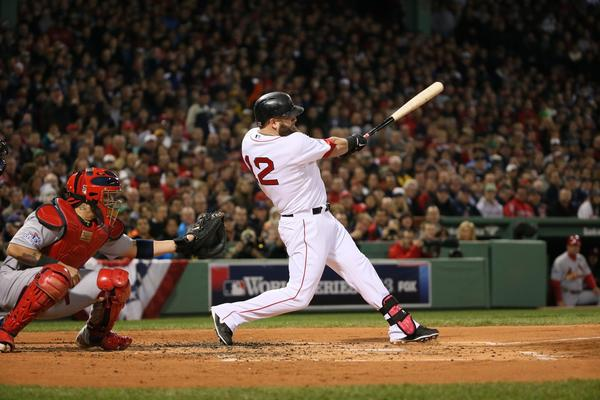 Mike Napoli drives in three runs with a double during the first inning of Game 1 of the World Series against the St. Louis Cardinals.