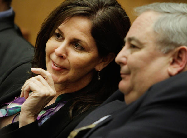 Former Bell assistant City Administrator Angela Spaccia confers with her former boss, Robert Rizzo.