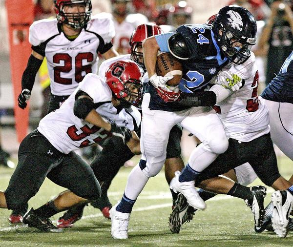 Crescenta Valley High's Kyle Tavizon, who was tackled by the Glendale defense last Friday, is working toward another big effort against Hoover. (Roger Wilson/Staff Photographer)