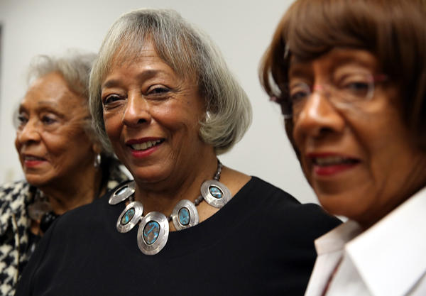 The daughters of Jesse Owens -- Gloria Hemphill, left, Marlene O. Rankin, center, and Beverly Prather -- at CPS headquarters.
